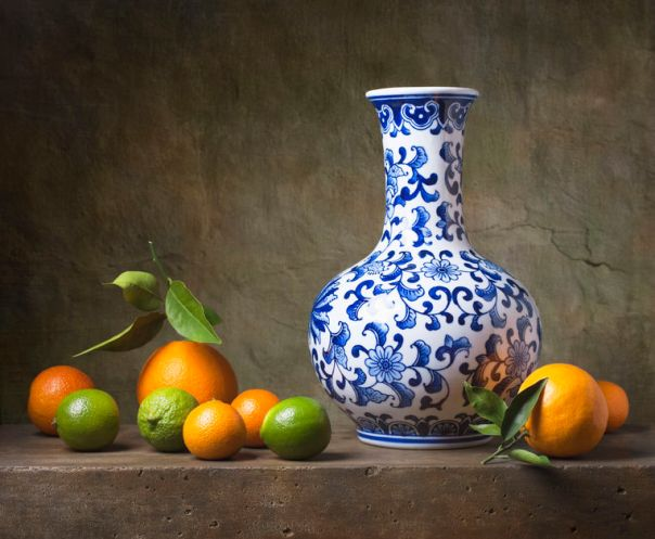 26086524 - still life with chinese vase and fruit